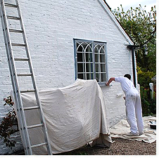Another shot of painting the side wall of Woodbine Cottage