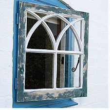 A window that has aged, and is ready for redecoration