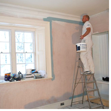 Painting a wall at Boothby Manor